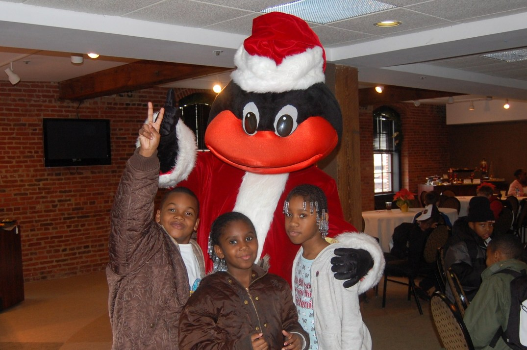 """""""Very Melo Christmas"""" at the Warehouse at Oriole Park in Camden Yards where the Carmelo Anthony Foundation teamed up to give 50 Baltimore children food, fun and presents.  A Merry (Melo) Christmas, indeed."""